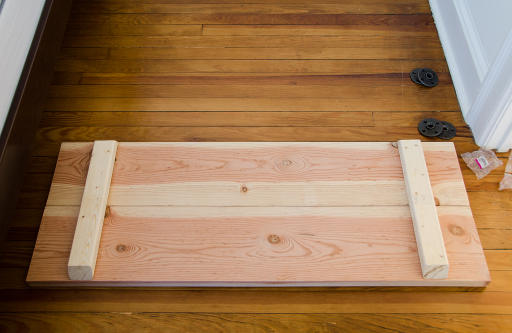 Two four foot boards and supports attached.